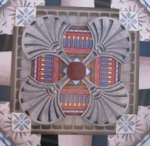 The centre section of the collage depicts a small area of the Minton tile flooring found throughout the villa and the red, blue and cream coloured repeated pattern which was found on the internal walls of the house beneath layers of modern paper and paint .