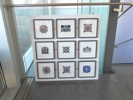 The postcard collages were mounted on a white board and placed in front of glass panelling.